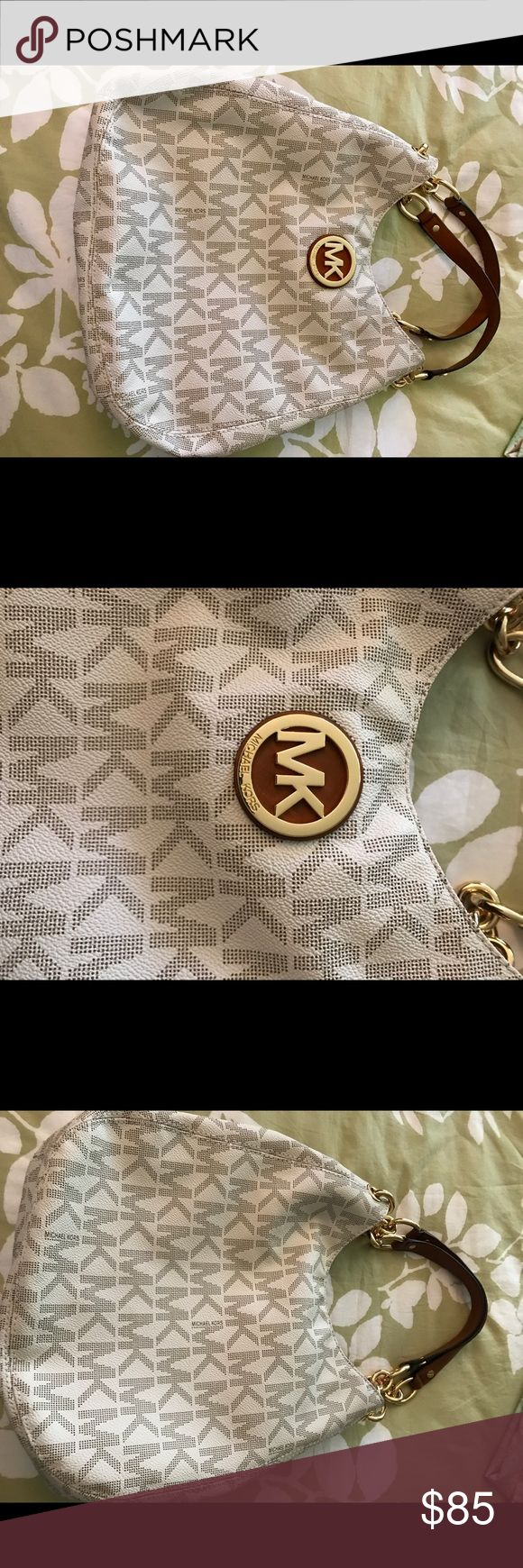 Michael Kors purse MK purse that is white with brown lettering. Medium sized bag that can fit on your shoulders. Only used it once to match an outfit. It's in perfect condition. Comes from a smoke free and animal free home. It is on the heavy side because of the handles but it fits a ton of stuff because it has three sections. Michael Kors Bags Shoulder Bags