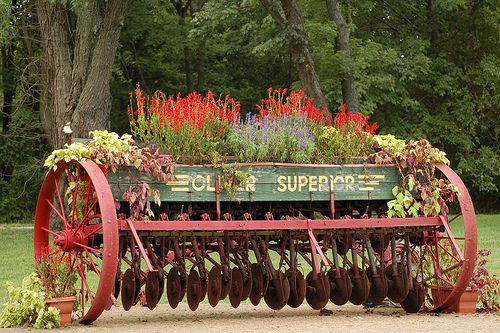 old farm equipment used as flower containers | Recent Photos The Commons Getty Collection Galleries World Map App ...