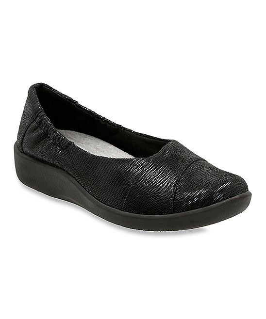 Clarks Black Lizard Sillian Intro Flat | zulily  . $44.99 $85.00  .( SIZE  CHART )  .http://www.zulily.com/6d98bb0c-c95e-480b-8be4-bd4412c0b91bpng   .Description:  Cushioned footbed & shock-aborbing sole work together 2 cradle your feet in comfort when sliding into these minimalist & modern sneakers.      1.5'' heel .     Clark Collection     OrthoLite® cushioned footbed     Cloudsteppers heel .     Shock-absorbing sole .     Man-made upper .     Textile lining .EVA sole  .Imported