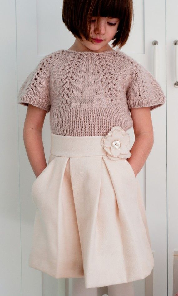 Such a pretty outfit for a little girl.  I aspire to make such a skirt and knit a beautiful sweater like this one.