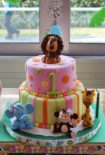 Adorable jungle animal birthday party cake! See more party ideas at ...