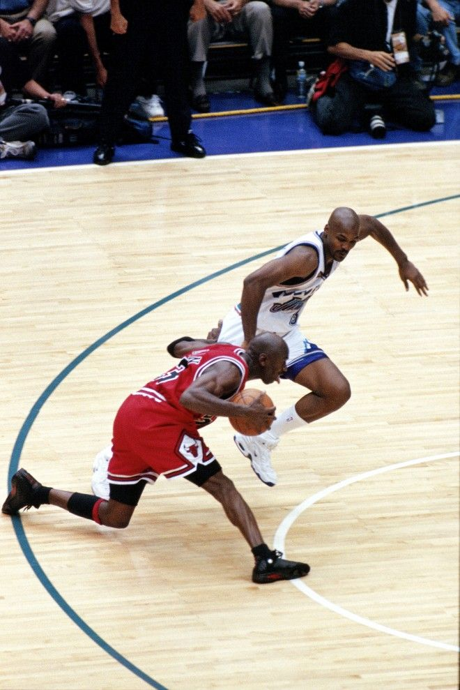 Michael Jordan #23 of the Chicago Bulls dribbles past Bryon Russell #3 of the Utah Jazz prior to hitting the game winning jumpshot during game six of the 1998 NBA Finals played on June 14, 1998 at the Delta Center in Salt Lake City, Utah. Copyright 1998 NBAE (Photo by Scott Winterton/NBAE via Getty Images)