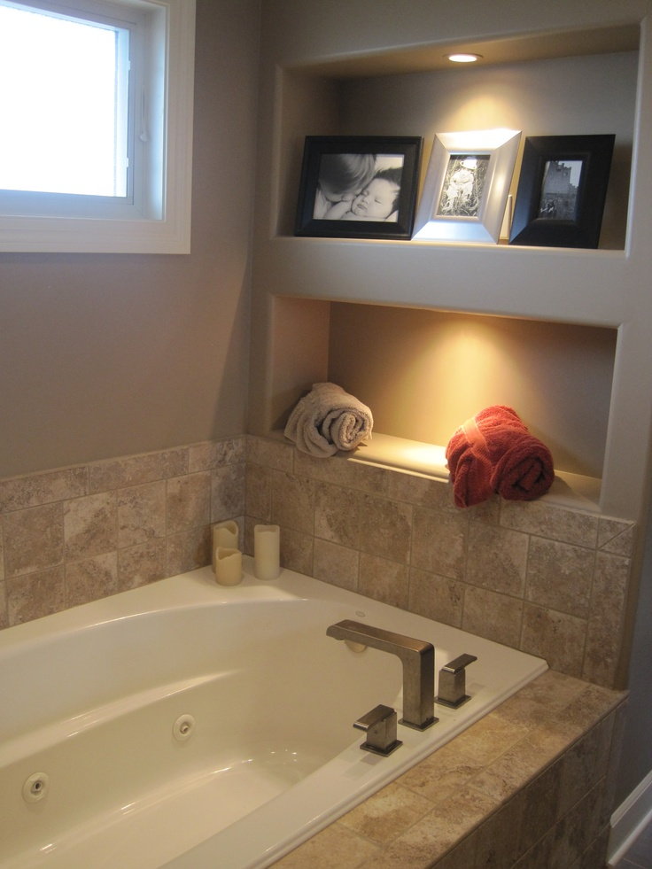Bathroom Reno- window, bath set up  but tiles to ceiling