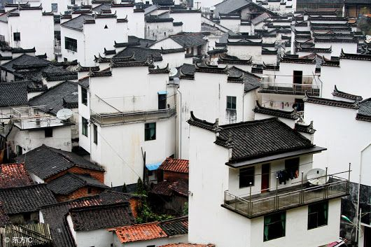 Village houses with traditional high fire walls in the round village in Jiangxi Province, a land of bamboo and home to feng shui art in southern China