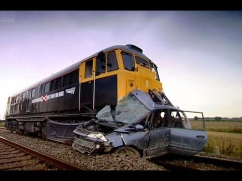 Top Gear's Jeremy Clarkson shows us what it is like for a train to hit on car that is parked on the tracks.