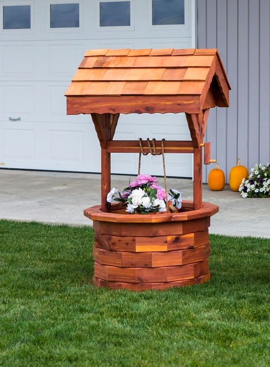 Large Amish Made Wishing Well  Amish Crafts Collection  Create a fantasy garden or a picturesque front lawn with the Large Amish Made Wishing Well taking center stage. This grand wishing well is a unique piece for anywhere to uplift your spirits.