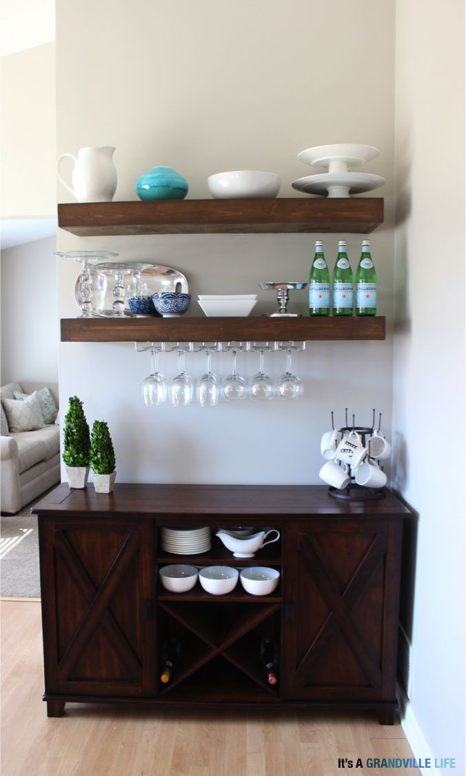 Wine rack under floating shelves in kitchen/dining area