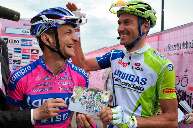 GIRO D'ITALIA – STAGE 18 - Michele Scarponi and Ivan Basso having a laugh at a photo from the 2010 Giro which Basso won