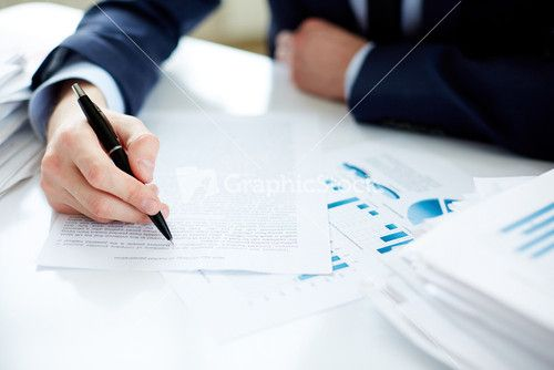 Hand Of Office Worker With Pen Making Notes
