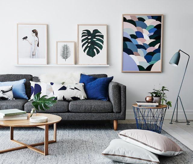 Textured Grey Carpet Charcoal Couch And Blue Accents