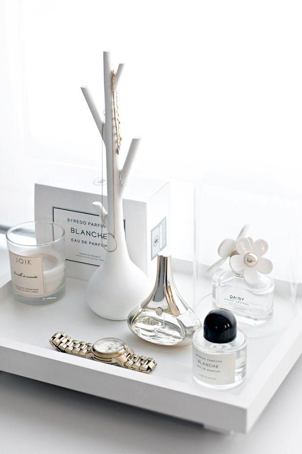 Side trays and artful ways of displaying jewels | loving the all white with golden accents.