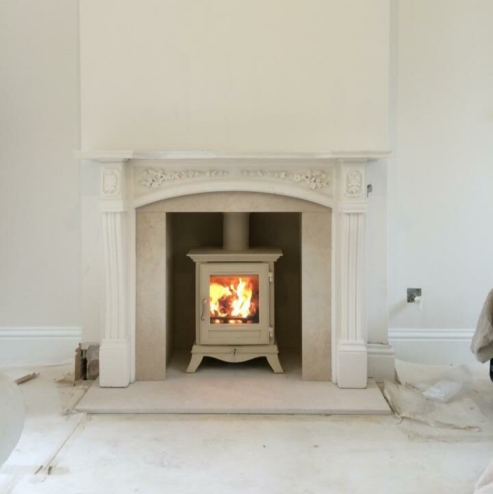 Chesneys Beaumont 4kw Ivory wood burning stove with limestone hearth and slips.