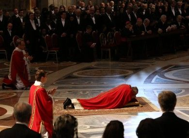 Pope Francis lies prostrate in prayer during the Good Friday liturgy