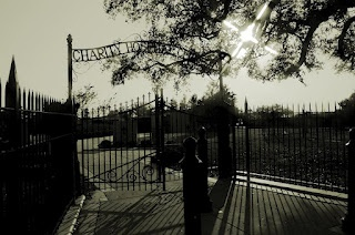 """New Orleans Katrina Memorial. Gate, which still reads """"Charity Cemetery,"""" the site upon which the memorial is built."""