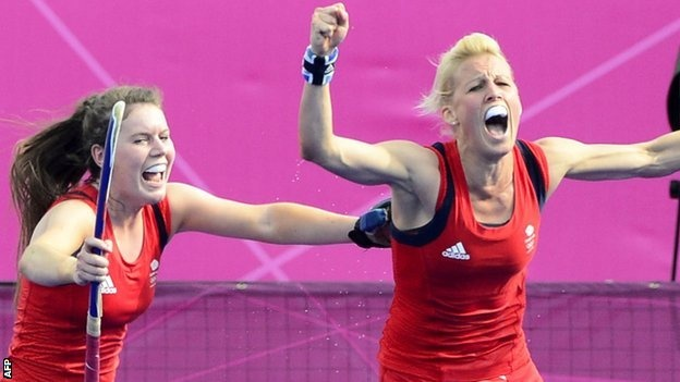 Alex Danson (right) celebrates after scoring for GB. Should we be happy about winning the Bronze in the words of Issac Hayes 'your dam right!'
