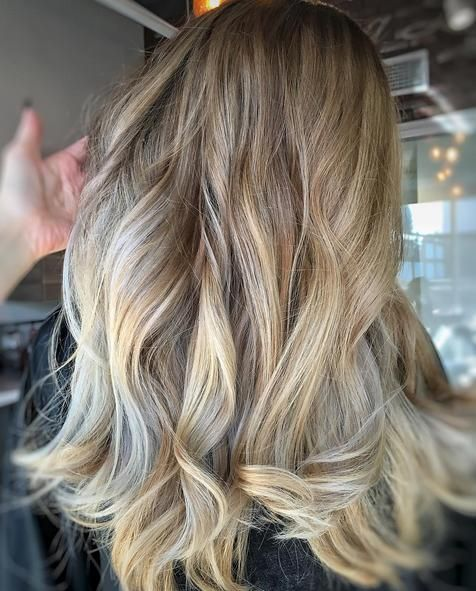 amazing blending job with loose curls call this color Iced Carmel mocha