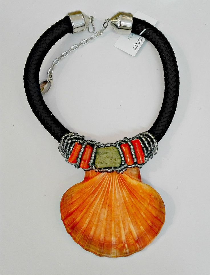 scallop and cord ,coral and seed beads