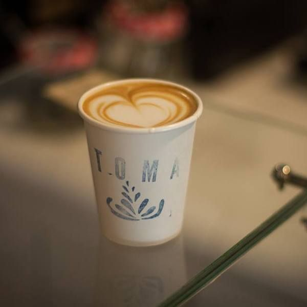 "Though toma means ""Take it"" in Spanish, this cafe offers more than takeaway service.   With a very intimate lounge, Toma's staff are able to interact with customers while showing off their impressive coffee knowledge as well as English.   Homemade pastries, cookies, and cakes are available and oc..."