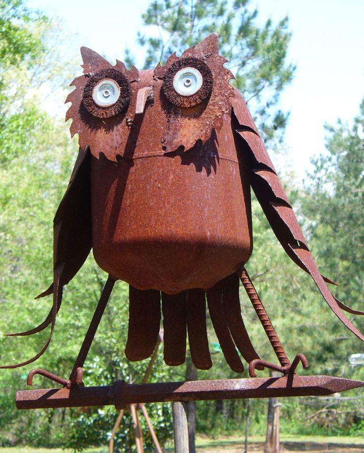 Owl. His body is a former propane tank and the eyes are the wire brush wheels off of a bench grinder.: