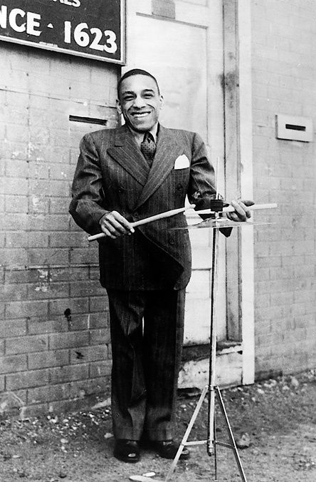 """Chick Webb was known as the first """"King of Swing,"""" and his style influenced artists such as Buddy Rich, Louie Bellson, and Duke Ellington."""