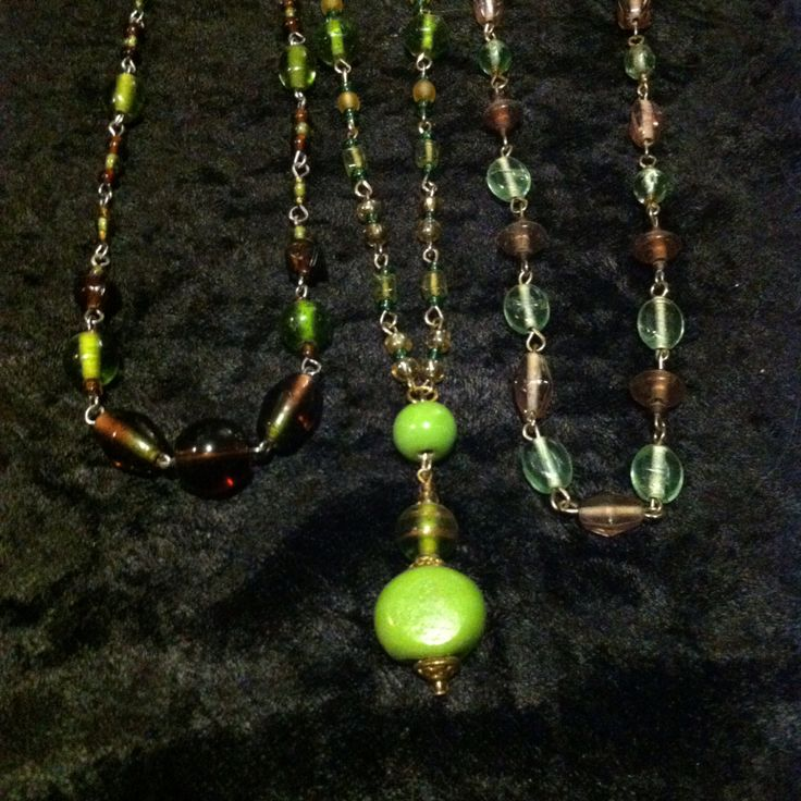 Green gleem. Made with glass, ceramic beads and metal accents.