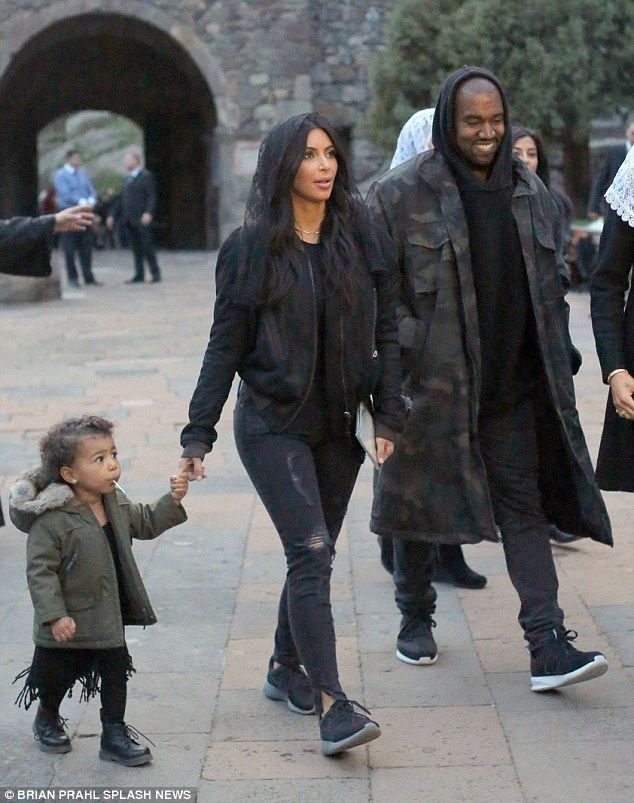 Family time: Kim can be seen holding North's hand while she and Kanye tour Armenia ...