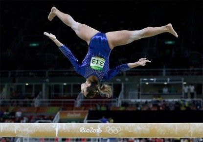 Brazil's Jade Barbosa performs on the balance beam during the artistic gymnastics women's team final at the 2016 Summer Olympics in Rio de Janeiro, Brazil, Tuesday, Aug. 9, 2016. (AP Photo/Rebecca Blackwell)