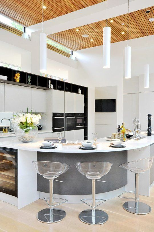 Contemporary style kitchen with a curved island counter