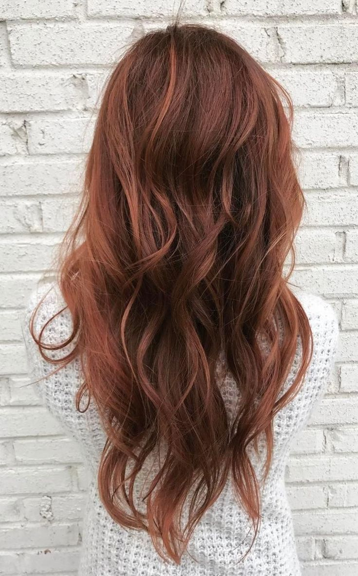 Aveda Artist Daniel Alexander used the color melting technique to get the perfect copper red hair color for this long haircut.