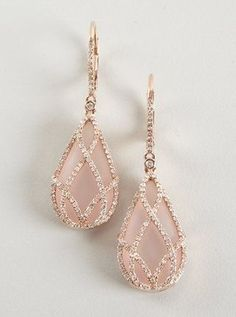 Vintage and beautiful earrings. Pink stone inside a diamond covered gold cage.
