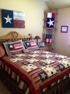 Texas Americana bedroom....ladder in corner is prop from latest 'Alamo' movie starring Dennis Quaid and filmed in Austin Tx