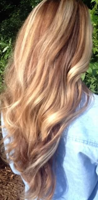 Warm honey golden color, caramel blonde balayage hair with sun-kissed highlights.