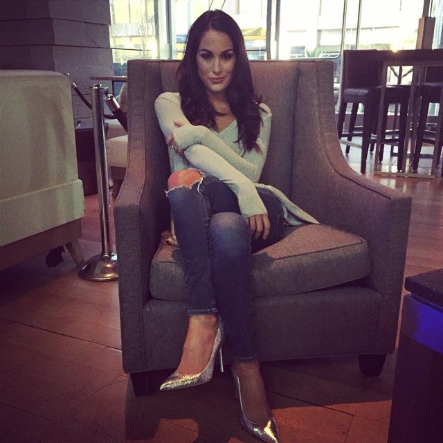 Comfy Chic from Dolled Up Divas  Brie Bella proves that even a simple sweater and jeans with heels is all she needs to turn heads.