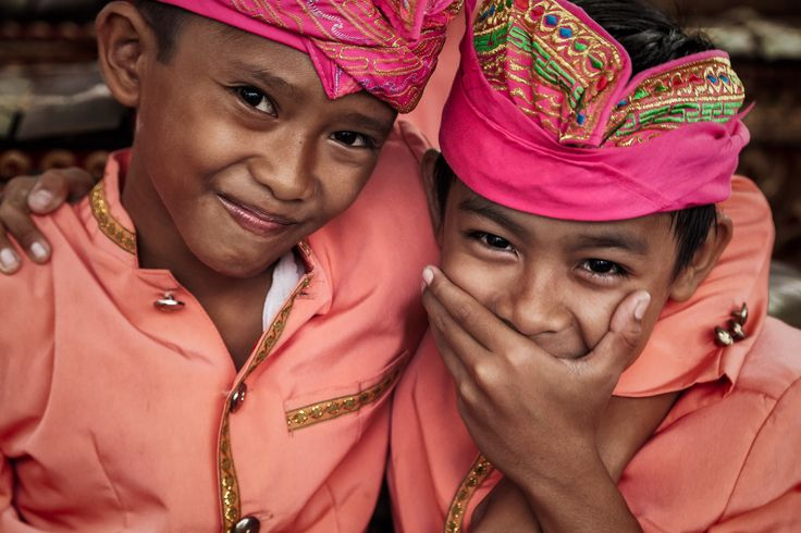 Two young boys, very much enjoying a moment of mirth, at a local band practice near Ubud, Bali.