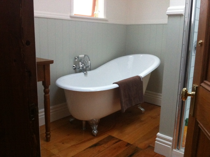 Cast iron claw foot bath - this bath was a compromise - I really wanted a slipper, and my husband wanted cast iron.  Fortunately, I was able to find a bath that had both.  The cast iron keeps it warm for hours.  I just love the bath sitting against the lemongrass colour