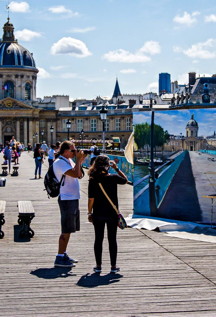 "Our Paris framed print captures a glimpse of everyday happenings on one of the city's most famous bridges, Pont des Arts. Connecting the Institut de France and the Louvre over the River Seine, few visitors to Paris will miss this bridge. Suitably titled ""Pont des Arts"", this 8″x10″ photograph is printed on fine art satin photographic paper, and is mounted and matted in a beautiful satin black 14″x16″ frame. This photo is available for a limited run of 10 prints, so get yours now!"