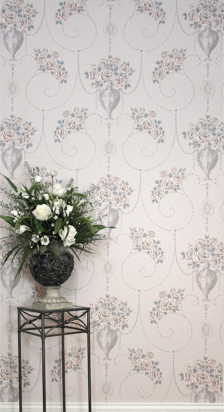 ANTONELLA is a design influenced by the European Renaissance era, which presents an artistic impression of woven fabric texture with overlays of delicate floral bouquets of Gallica Roses. This design is enhanced with an impression of hand painted finishes of metallic paint and watercolours, creating a three dimensional effect to this antique style.