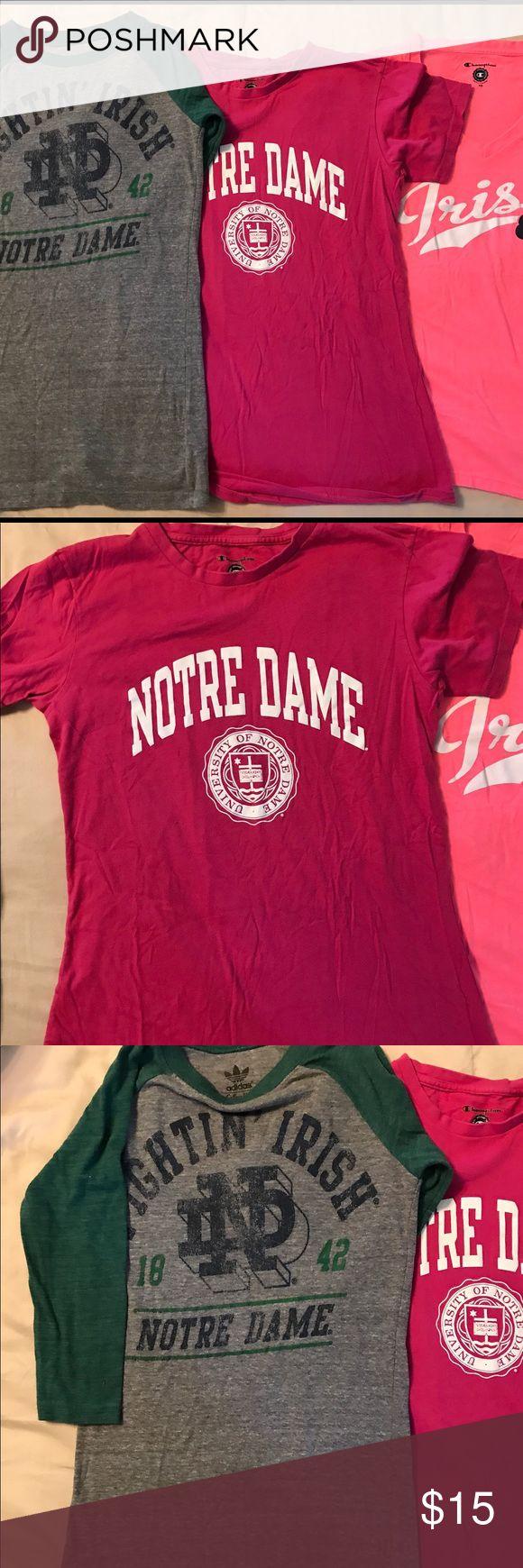 "Three Notre Dame Women's tee-shirts. Adidas XS gray/green, polyester/cotton/rayon blend ""Fightin' Irish"" tee, 3/4 length sleeves. Champion S fuchsia ""Notre Dame"" short sleeve tee, 100% cotton. Champion XS bright pink, short sleeve, fitted ""Irish"" tee, polyester/cotton. adidas Tops Tees - Short Sleeve"