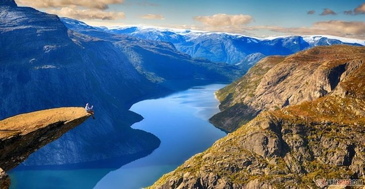 What you are about to see in the photos below is Trolltunga, a huge slab of rock that extends horizontally out of a rock cliff and hangs there, suspended about half a mile above the ground. (By the way, the landscape below is mesmerizingly beautiful, but let's stick to the ledge for now.) So, you are actually free to go hang out on the cliff, though you'd be wise to hear the authorities' advice: You will need sturdy hiking boots, bring extra clothing and be prepared for bad weather. Bring…