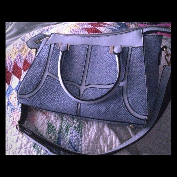Powder blue handbag. Used only about a week, excellent condition! Multiple pockets. Shoulder strap is removable. Replaced one missing zipper pull with cute charm. Bags Shoulder Bags