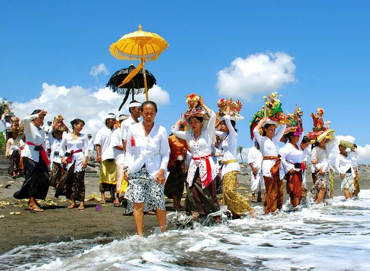 Melasti Ceremony ~ March18th &19th~ Three days before Nyepi on Mekiyis also known as #Melasti  all the effigies of the #Gods from #village temples are taken to the #rivers, #oceans, or water temples to be bathed by the Neptune of the #Balinese Lord, God Baruna.The #ceremony is aimed to clean all #nature and its content, and also to take the Amerta (the source for eternal life) from the ocean or sources of water. From morning to noon, there will be ceremonies on most Bali's #beaches. #nyepi…