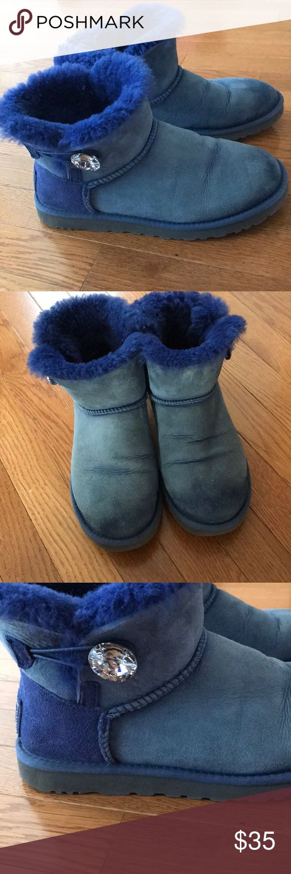 UGG Boots Uggs Blue Rare Rhinestone Size 8 UGG Boots Uggs Blue Rare Crystal Studded Size 8. Preowned in excellent condition. Has rhinestone studs on the back and a giant one on the sides. Very warm and cozy. Smoke free clean home. Ankle boots. Can be rolled down for a comfy look. They fit sizes 8-9. UGG Shoes Ankle Boots & Booties