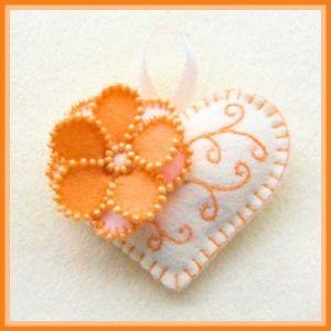 orange & white embroidered felt heart by clausatie