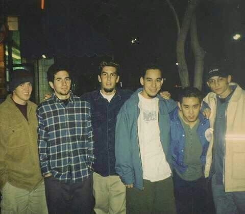 """1997 or 1998...I think this was the first photo we ever took together.  We had just told Chester that we wanted him to join the band.  He said he was ready to move out from Arizona to L.A.  We went to a pizza place near UCLA to hang out and talk about what to do next.  The band was called Xero at the time, and we probably had less than a half a dozen songs.  No flame tattoos yet, no red hair yet, most of us were still in college."" - Mike Shinoda"