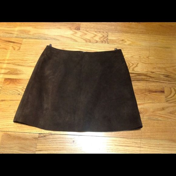 """Benetton suede skirt Chocolate brown suede mini skirt by Benetton. Could be a great staple in someone's fall/winter wardrobe. Made in Romania. Lined. The skirt is a 42 which Benetton considers a medium. The waist measures 14.25"""" when laid flat. This would be close to a size 4, I believe. Skirt has some minor spots on the front which I don't believe anyone would notice. See last picture. Benetton Skirts"""