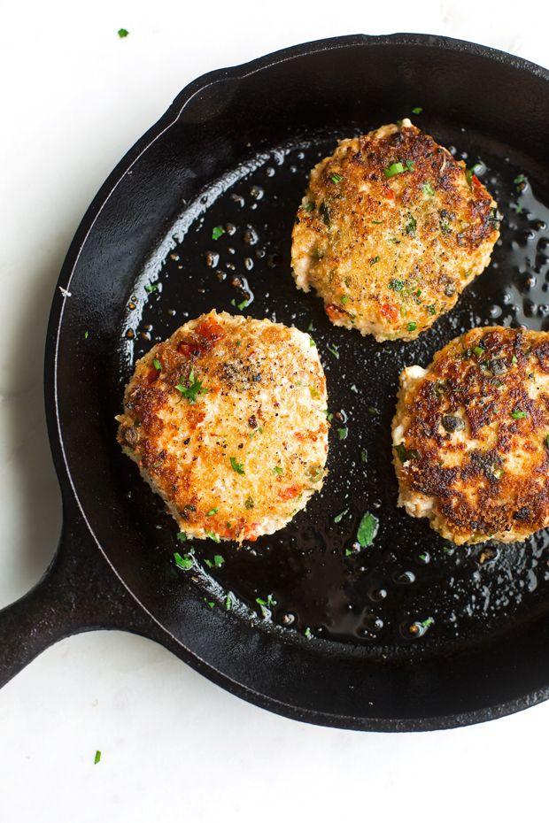 Salmon Burgers with Cajun Remoulade Sauce - A simple salmon burger that tastes gourmet! Topped with homemade remoulade sauce! #salmonburger #remouladesauce #salmoncakes #salmonpatties   Littlespicejar.com