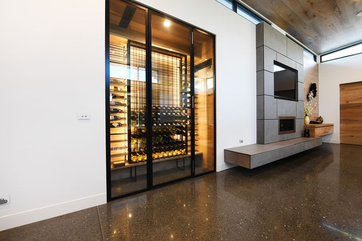 Kitchen, Dining with glass wine room  Vine & Vault Custom Cellars