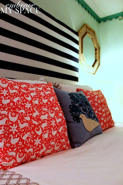 Bold stripes and otomi-inspired fabrics are stunning in this DIY headboard design. #DIY #headboard
