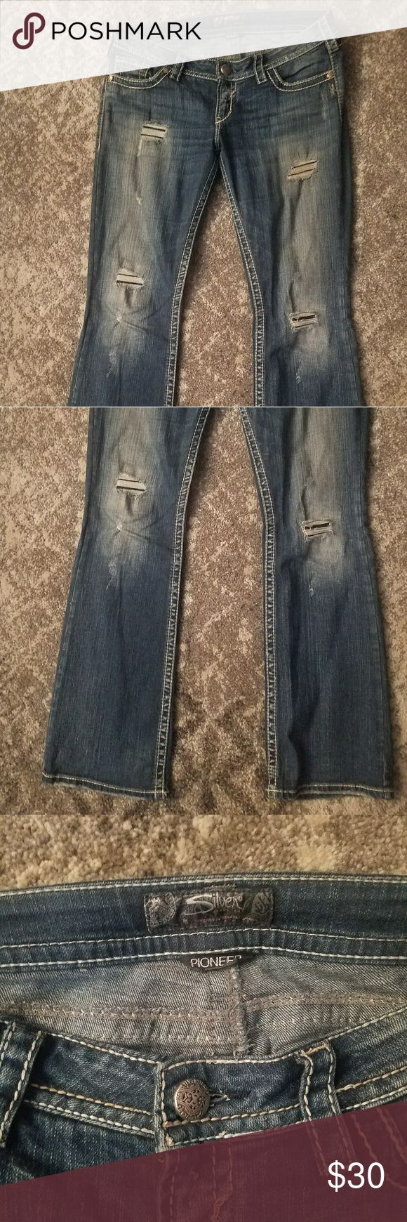 """Women's silver jeans Women's silver pioneer jeans 30x33 dark wash. """"Holes"""" have patches behind so they aren't see thru. Excellent condition. Only wore a few times. Silver Jeans Jeans Flare & Wide Leg"""