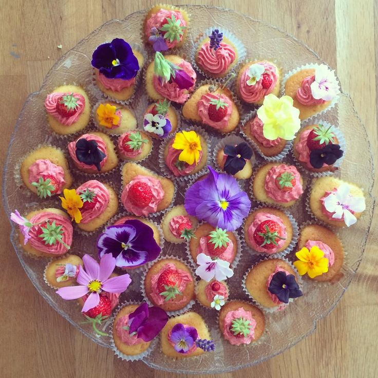 """Today Oscar's little sister and I made strawberry cupcakes and decorated them with wildflowers from the garden.   I realize now that there hasn't been enough photos of cupcakes on this blog and for that I apologize. Have a happy Sunday, you guys heart emoticon"" - https://www.facebook.com/carolinecallowaydotcom/photos/pb.176569062526763.-2207520000.1460745928./275220192661649/?type=3&theater"